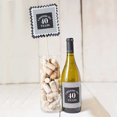 black and silver milestone birthday centerpiece and wine label