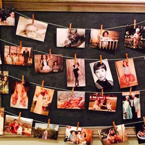 70 years on photos pegged on string