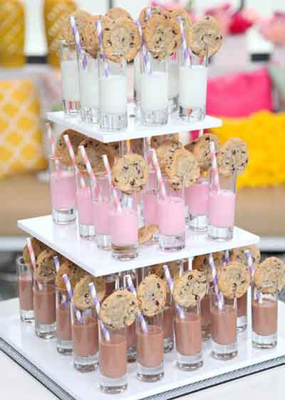 milk and cookies arranged on levels