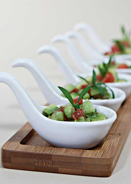 avacado salsa on appetizer spoons
