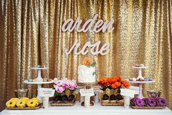 gold glitter fabric dessert table