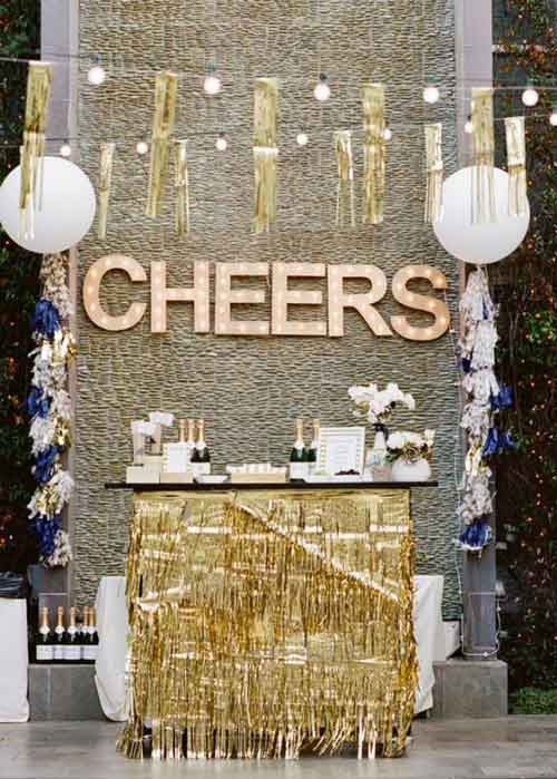 dessert table with letter backdrop