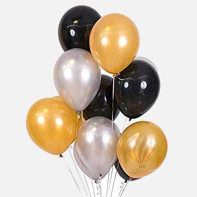 black, gold, white balloons