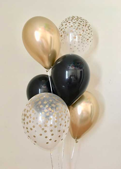 gold, black, and clear confetti balloons