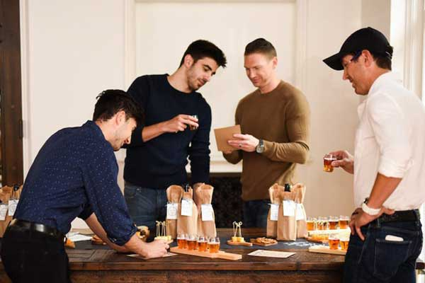 men at beer tasting party