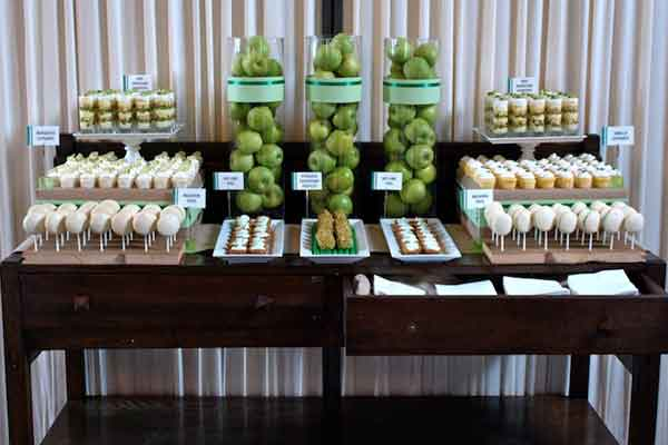 green and white dessert buffet table