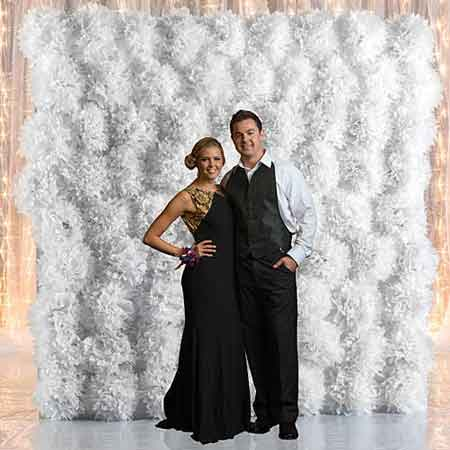 photo booth backdrop board with tissue poms