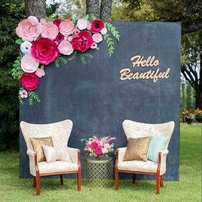 paper flowers and chalkboard backdrop