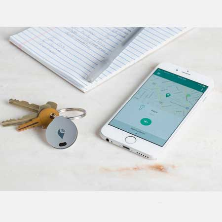 Coin size tracker devices