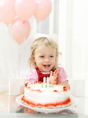 toddler girl with birthday cake